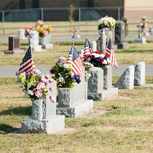 Headstones, flowers, and flags at Vernon Cemetery