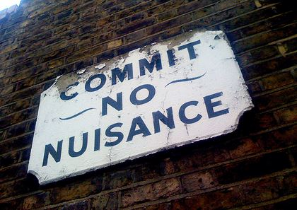 A Sign Which Reads: Commit No Nuisance