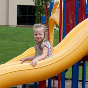 Girl on a Yellow Slide
