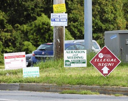 A collection of signs on street corner